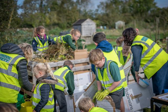Oakridge School Allotment children making a compost heap